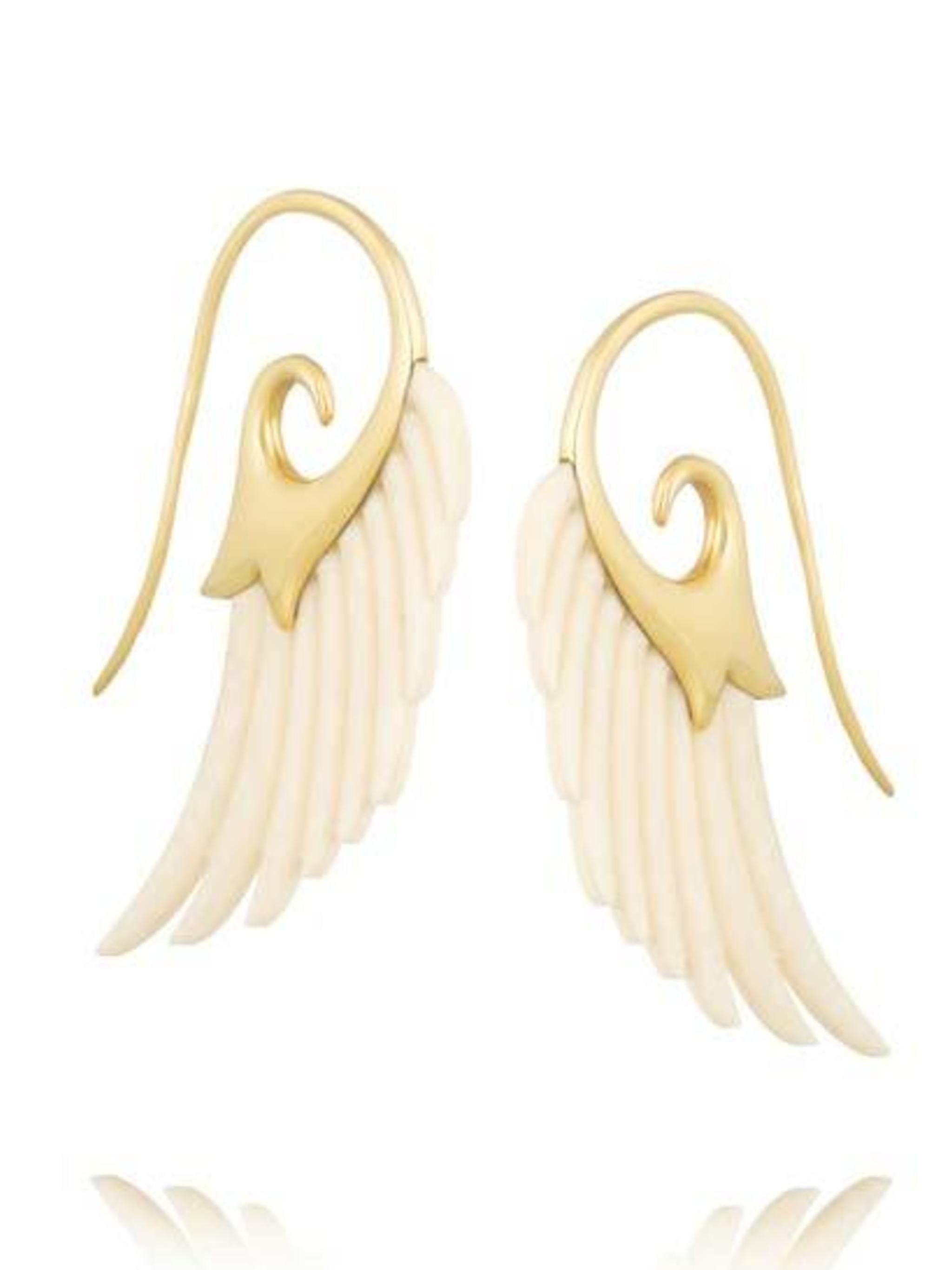 "<p>Noor Fares is a favourite among us here at ELLE. We would be blown away if we received <a href=""http://www.net-a-porter.com/product/429636"">these</a> beautiful Wing Gold and Ivory earrings, £1,835. </p>"