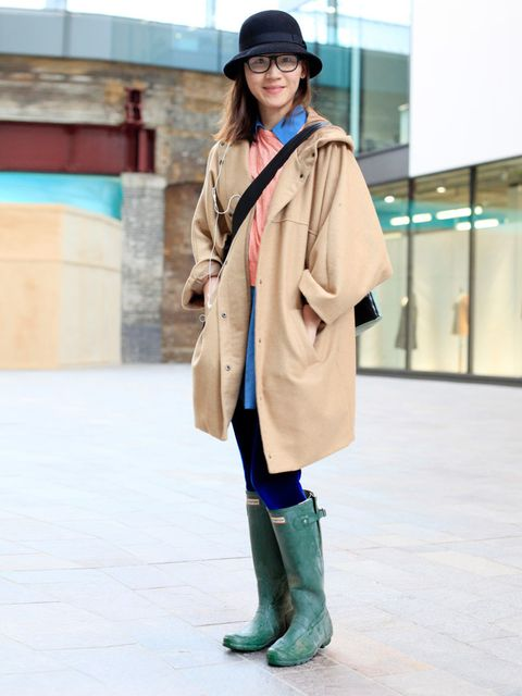 <p>Riqi, 23, Urban Outfitters hat, Cheap Monday coat, Cos top, Hunter wellies.</p><p>Photo by Silvia Olsen @ Anthea Simm</p>