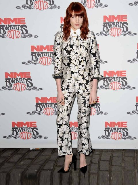 """<p><a href=""""http://www.elleuk.com/star-style/celebrity-style-files/florence-welch"""">Florence Welch</a> wearing <a href=""""http://www.elleuk.com/catwalk/designer-a-z/moschino/spring-summer-2012"""">Moschino</a> at the NME Awards 2012 in London</p>"""