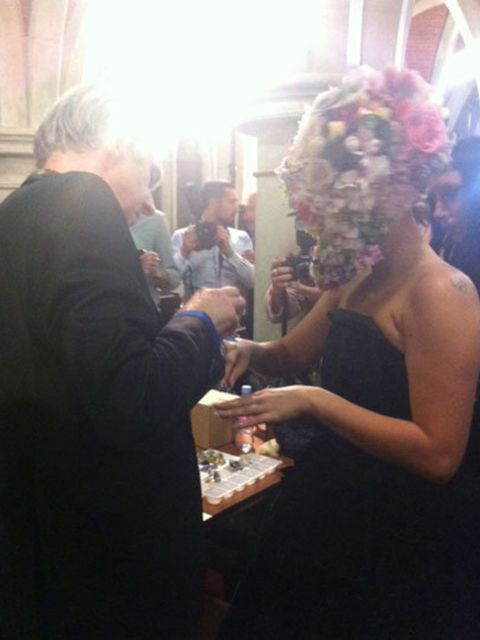 <p>Philip Treacy shows Lady Gaga the huge blue ring she will be wearing on the catwalk</p>