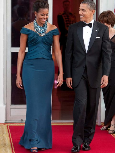 Barack Obama & Michelle Obama arrive at the State dinner for the Prime Minister of Great Britain at The White House.