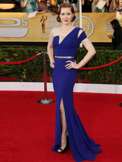 "<p><a href=""http://www.elleuk.com/elle-tv/cover-stars/elle-magazine/amy-adams-elle-behind-the-cover-video2"">Amy Adams</a> wears a blue Antonio Berardi dress with an embellished crystal waistline styled with a Ferragamo clutch and Jimmy Choo <em>Vibe</em>"