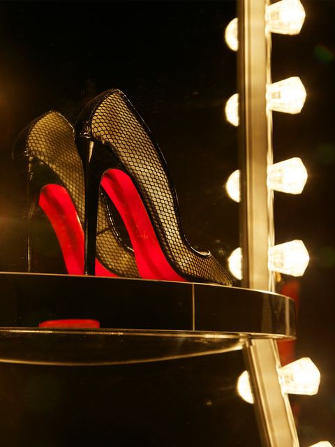 <p>Christian Louboutin shoes in a cabaret-themed at the Design Museum</p>