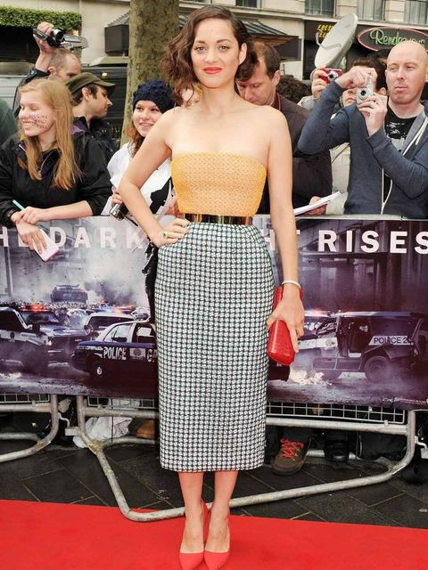 <p>Marion Cotillard attends the European premiere of The Dark Knight Rises in London's Leicester Square. She plays Miranda Tate – who is part of Bruce Wayne's company – in the film, and wore Christian Dior for the premiere.</p>