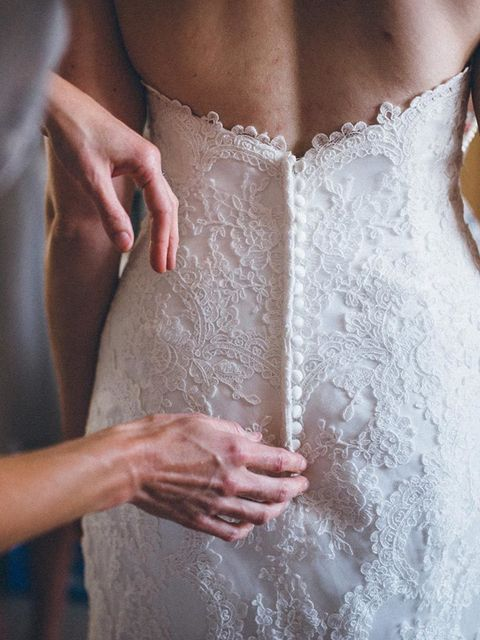 <p>The dress was originally strapless, which wasn't what I had in mind, but the shape was perfect. So I ordered extra material and a very talented friend made the top lace piece that buttoned into the back of the dress.</p>