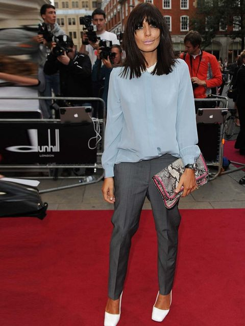 """<p>Claudia Winkleman wears a Peter Pan-collared chiffon blouse, grey trousers and white <a href=""""http://www.elleuk.com/catwalk/designer-a-z/jil-sander/spring-summer-2013"""">Jil Sander</a> patent leather pumps to the fashion GQ Men of the Year Awards</p>"""