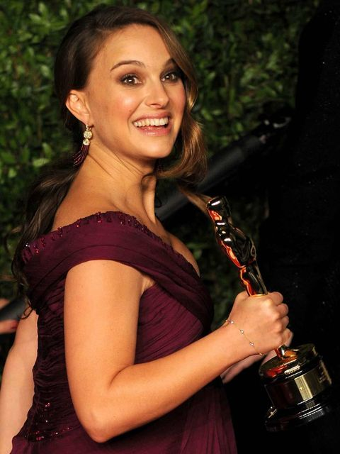 <p>Pregnant Natalie Portman wearing Rodarte to collect her 'Best Actress in a leading role' award at the Oscars, February 27, 2011.</p>
