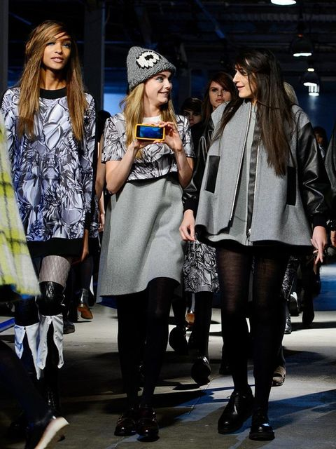 """<p><strong>Best multi tasking:</strong></p><p><a href=""""http://www.elleuk.com/star-style/celebrity-style-files/cara-delevingne-s-style-file"""">Cara Delevingne</a> filming herself and the front row on the <a href=""""http://www.elleuk.com/catwalk/designer-a-z/gi"""
