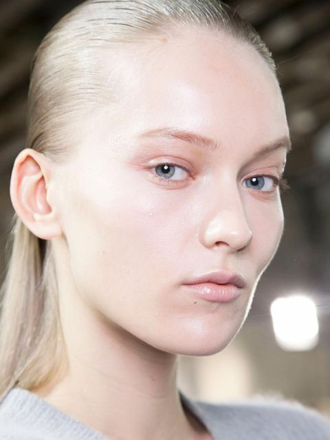 <p>Make-up artist Val Garland was inspired by women today when she created this barely-there, yet beautiful make-up look. At the corner of each eye Garland used a flat, square brush to paint on a graphic slick of pearlescent, translucent shimmer that caug