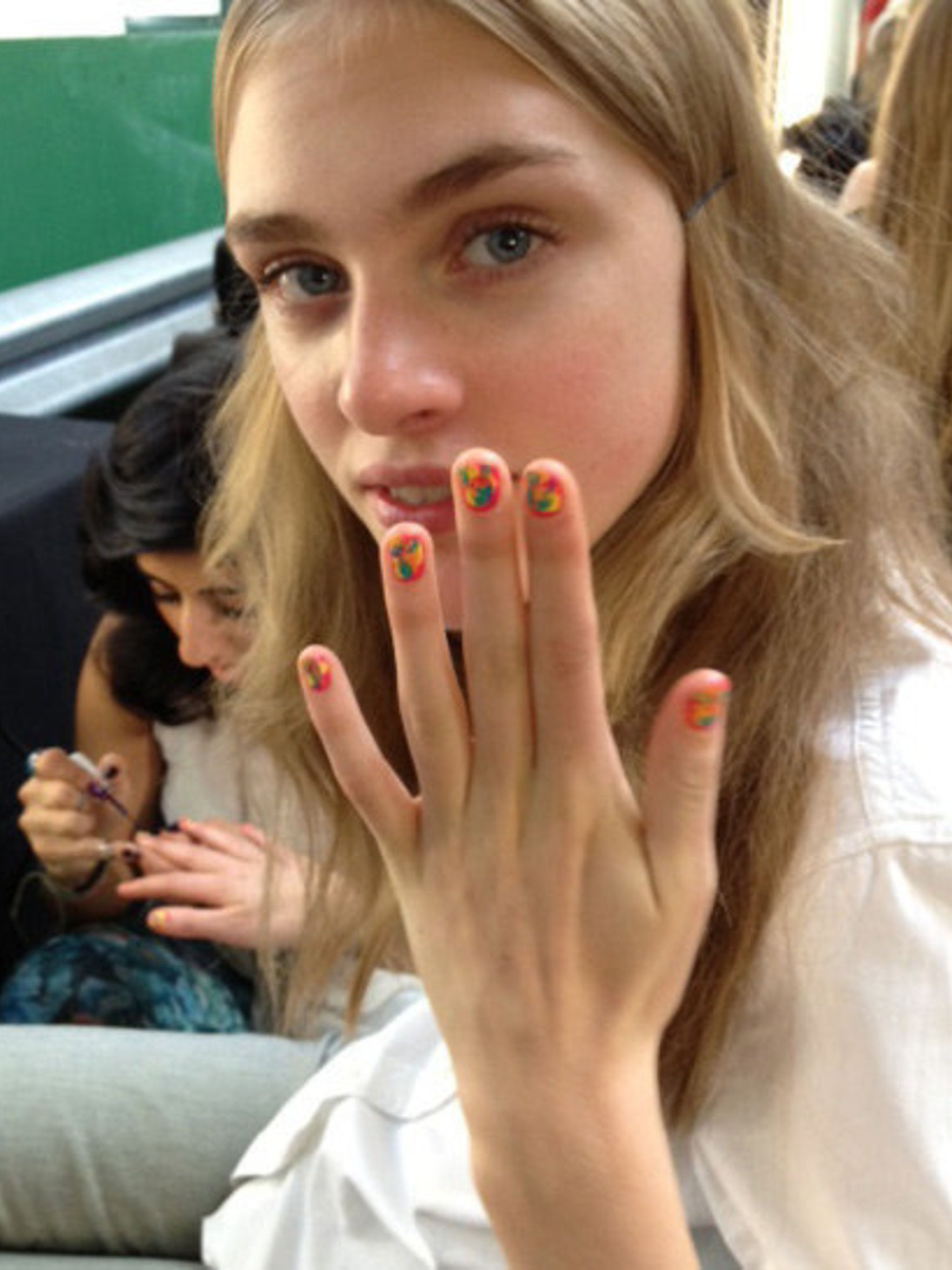 "<p>Nail queen <a href=""http://www.elleuk.com/beauty/beauty-notes-daily/from-raving-tips-to-painterly-pins"">Sophy Robson was inspired by a nineties rave</a> to create these painterly tips. </p>"
