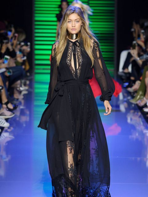 Gigi walks the Elie Saab runway in Paris.