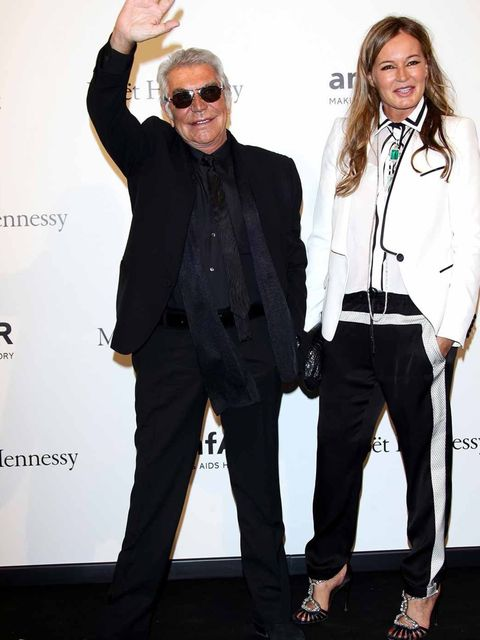<p>Roberto Cavalli and Eva Cavalli attend the amfAR gala during Milan Fashion Week.</p>