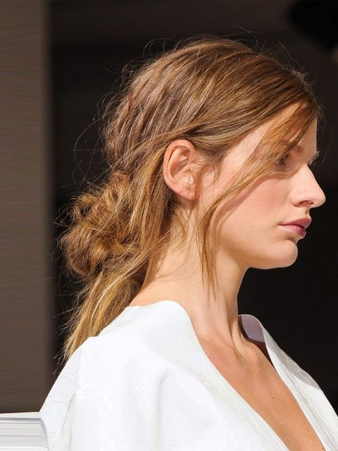 "<p><strong>Hair by:</strong> Paul Hanlon for Tigi</p><p>A favourite with Lorraine, this mussed-up, knotted ponytail was 'inspired by the girls in the <a href=""http://www.elleuk.com/catwalk/designer-a-z/marni/spring-summer-2013"">Marni</a> office', revealed"