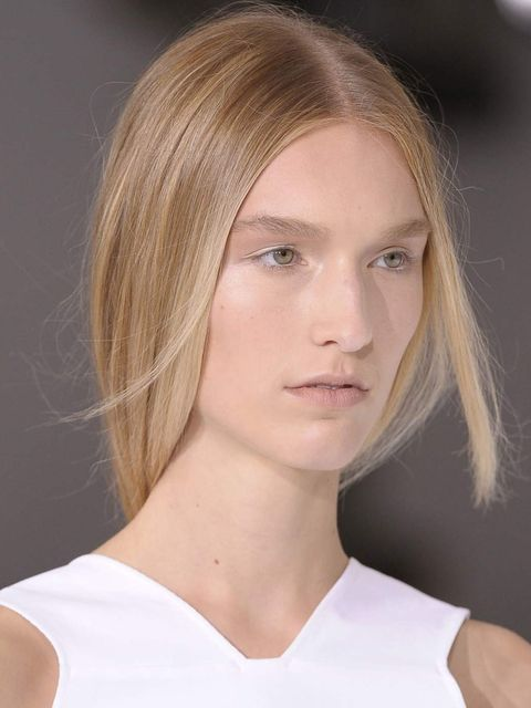 "<p><strong>Hair by:</strong> Guido for Redken</p><p>Forget the irons for this <a href=""http://www.elleuk.com/catwalk/designer-a-z/jil-sander/spring-summer-2013"">Jil Sander</a> look, blow-dry your hair straight. Then rub a little Redken Glass Look 01, £17."