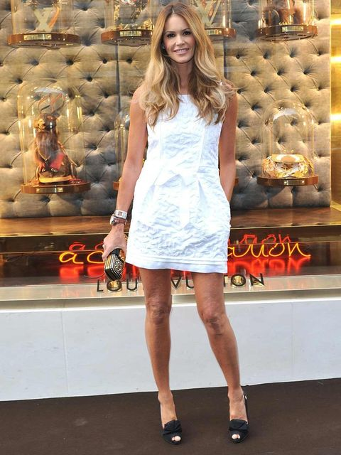 <p>Elle Macpherson at the unveiling of the Louis Vuitton New Bond Street Maison in a white shift dress, May 2010.</p>