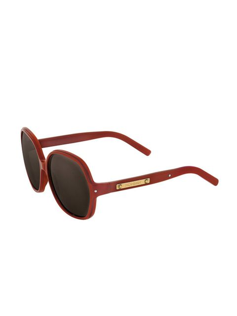 <p>Red oval sunglasses, £159, by Yves Saint Laurent (01423 520 303)</p>