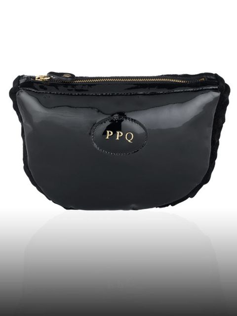<p>Fallon make-up bag, £175 by PPQ. For the stockist call 0207 494 9789.</p><p>Kimberly was front row at the PPQ A/W 08 show in London and found this fabulous make-up bag among the goodies she received from the designers and has been using it ever since.<