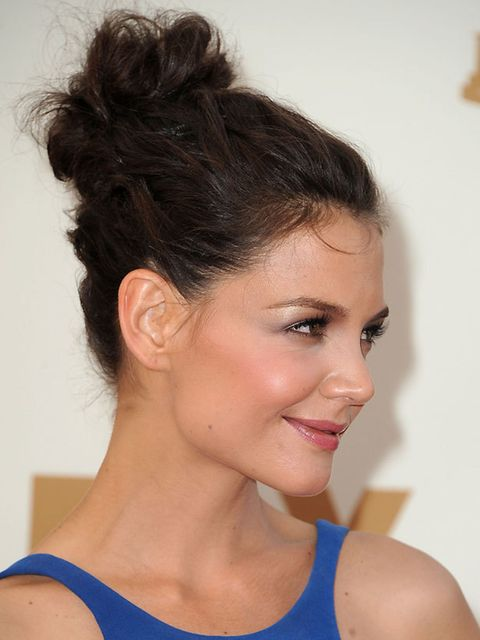 """<p>Katie Holmes proves that the dolly bun isn't going anywhere. <a href=""""http://www.elleuk.com/beauty/celeb-beauty/celeb-hair/(section)/celeb-watch-dolly-bun"""">See which other stars love a topknot...</a></p>"""