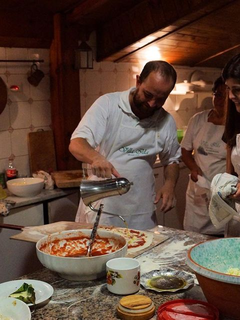 """<p>The night before the wedding we did pizza-making at <a href=""""http://www.villaidasorrento.com/"""" target=""""_blank"""">Villa Ida</a>, rather than doing the formal rehearsal meal. We wanted the activity to be an icebreaker, making the big day even more special"""
