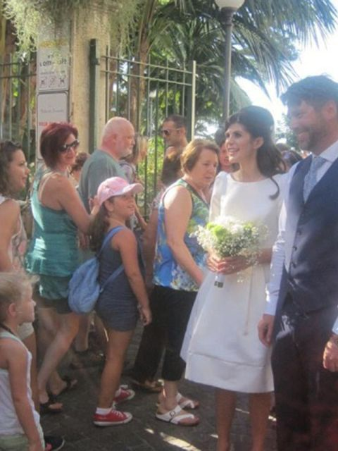 """<p>My wedding dress was a Fifties Duchesse dress from <a href=""""http://www.suzannah.com/"""" target=""""_blank"""">Suzannah</a> in London. I wanted a shorter dress, and I also wanted one that I could wear again - so the plan is to eventually have it dyed.</p>  <p>T"""