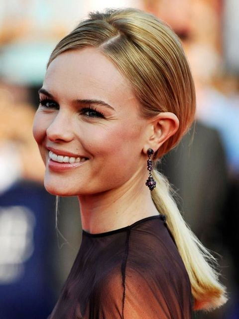 <p>If you hadn't already noticed ponytails are going to be huge this season. Kate has opted for a sleek ponytail worn at the nape of the neck. She's ensured it's flattering by side parting the front section and slightly backcombing the crown for extra hei