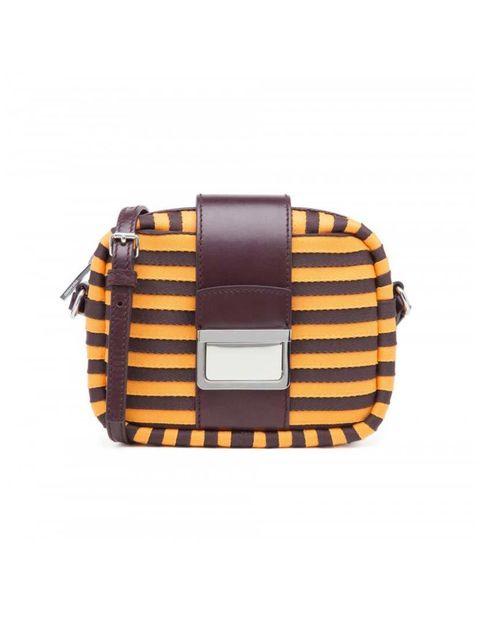 "<p>Fashion Intern Emi Papanikola isn&#39;t shy of a bold accessory.</p>  <p><a href=""http://www.bimbaylola.com/shoponline/product.php?id_product=11847&amp;id_category=820"" target=""_blank"">Bimba y Lola</a> bag, &pound;135</p>"
