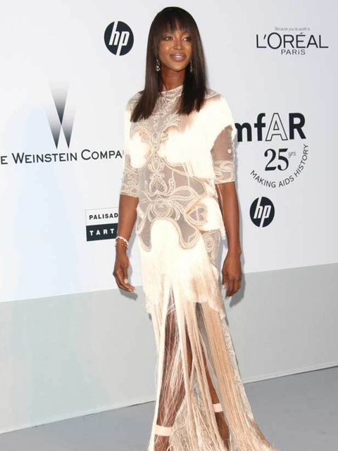 "<p><a href=""http://www.elleuk.com/starstyle/style-files/(section)/naomi-campbell"">Naomi Campbell</a> in a <a href=""http://www.elleuk.com/catwalk/collections/givenchy/autumn-winter-2011/collection"">Givenchy</a> Couture tassled gown at amfAR's Cinema Agains"