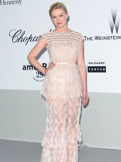 """<p><a href=""""http://www.elleuk.com/starstyle/style-files/(section)/kirsten-dunst"""">Kirsten Dunst</a> in <a href=""""http://www.elleuk.com/catwalk/collections/chanel/autumn-winter-2011/review"""">Chanel</a> Couture at amfAR's Cinema Against AIDS Gala during the Ca"""