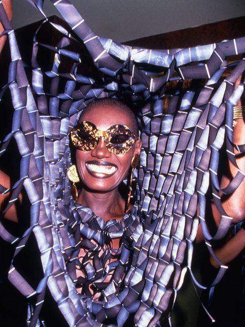 <p>A very smiley Grace Jones back in 1978 wearing a spider web like headpiece in Studio 54, 1978.</p>