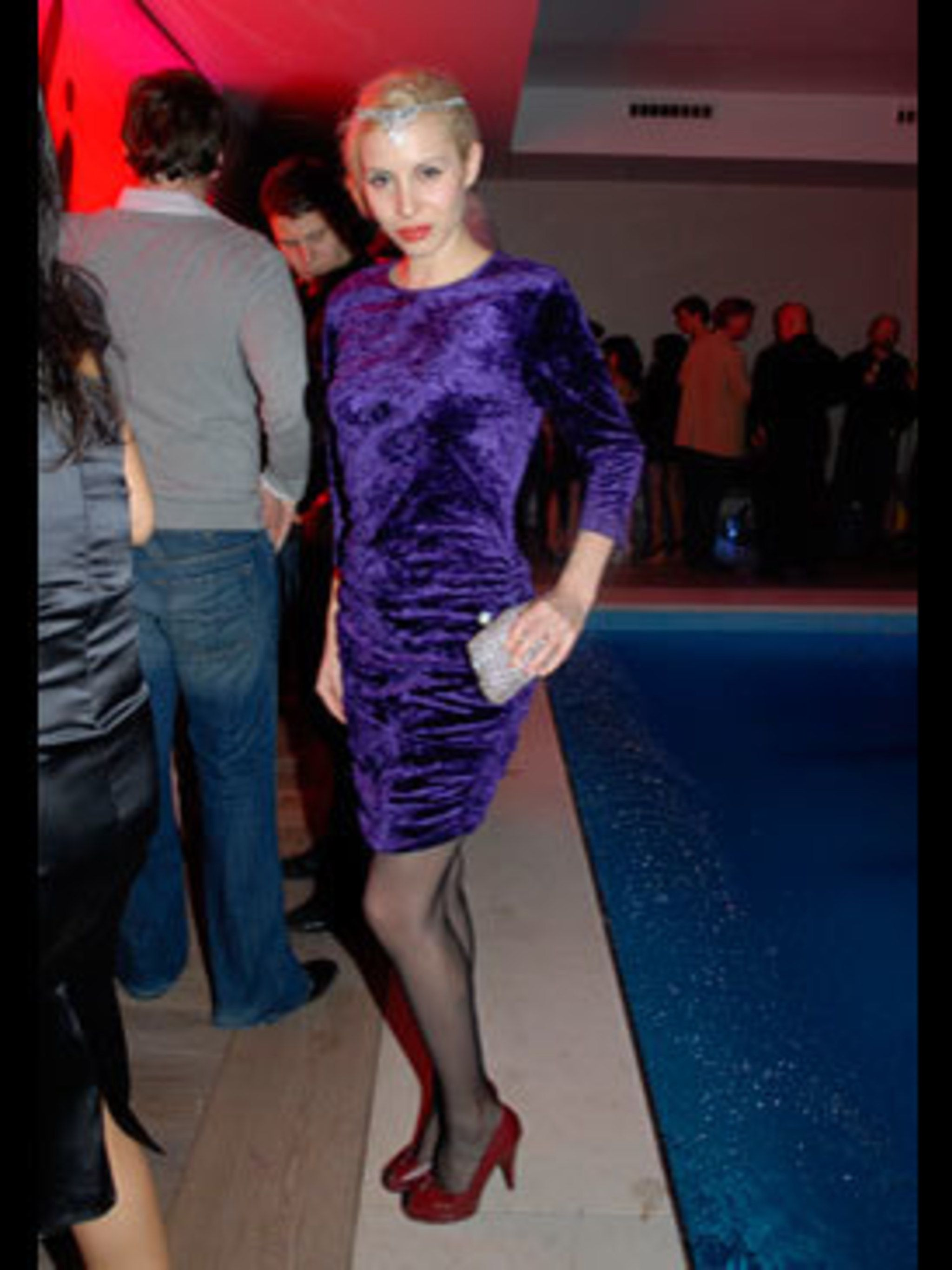<p>Annette's fabulous crushed velvet, body conscious dress from Beyond Retro works so well because she exudes confidence - her Agent Provocateur stockings may have something to do with that. </p>