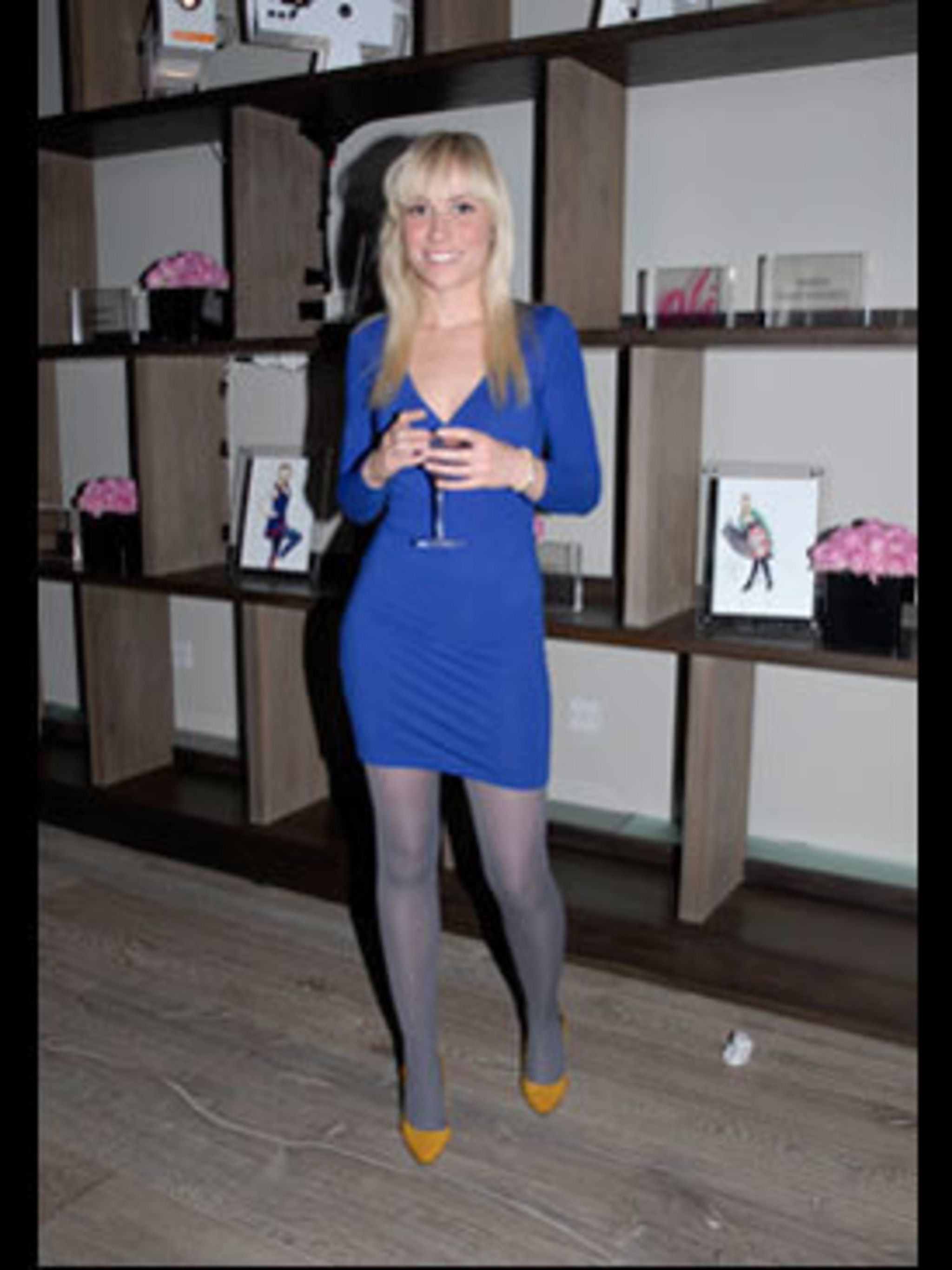 <p>How amazing is Jessica's body concious dress? She got hers from the kings of lycra, American Apparel. The grey tights, also from American Apparel, look much softer than black opaques, while her mustard courts from Absolute Vintage round off this simply