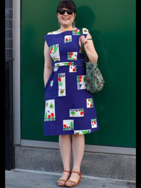 <p>We love this 50s dress, the blocks of graphic florals give it a quirky flare. Pairing a flouncy dress with Ray-Ban Wayfarers achieves a fun look that Lily Allen would be proud of.</p>