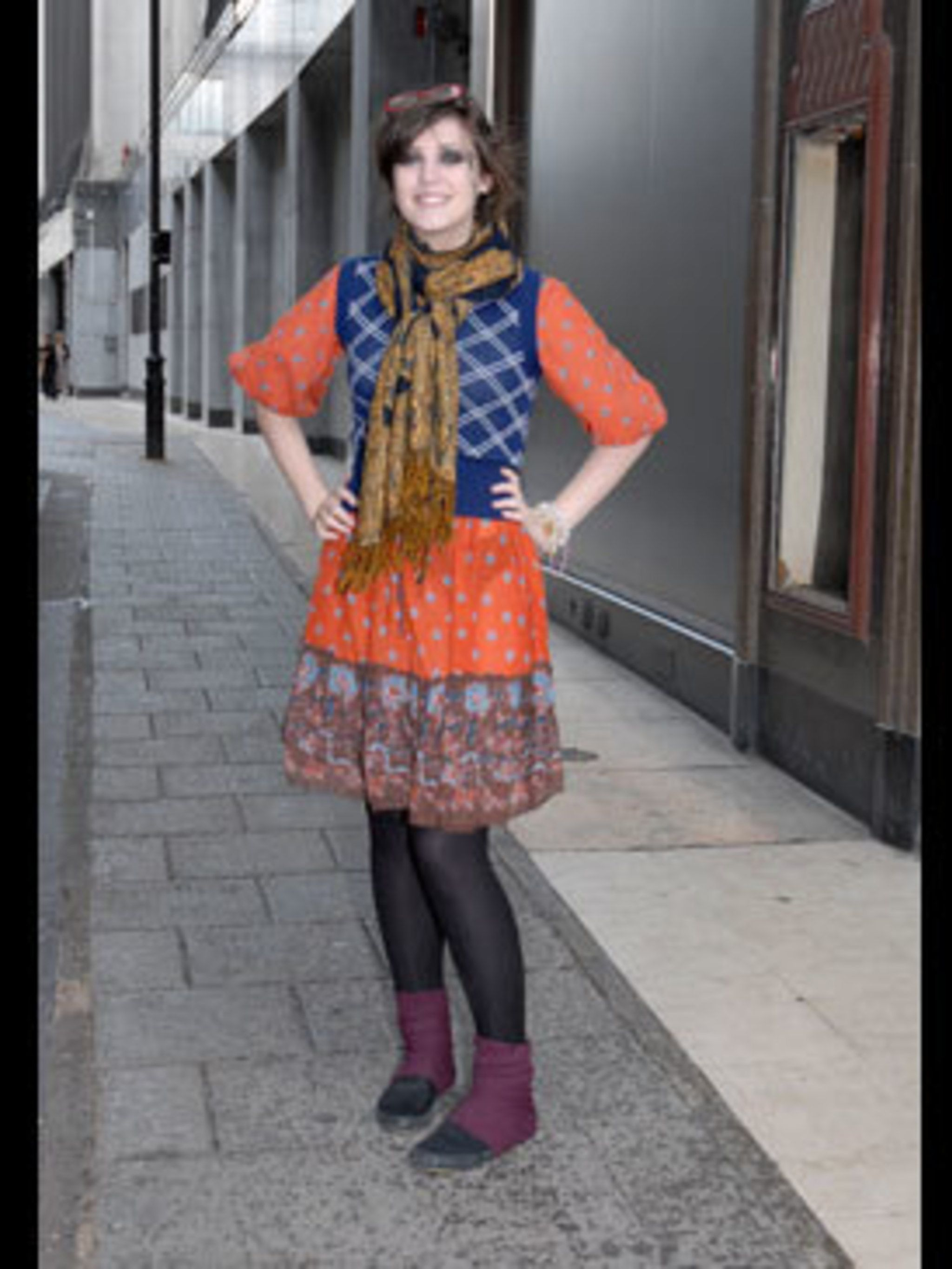 <p>Emily has gone all out, combining textures and clashing prints and carrying it off with uber confidence. She makes her own clothes and sells them online, so she knows what looks fabulous. Her plum leg warmers sit well with the purple detailing on the h