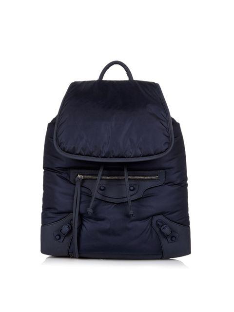 "<p>Balenciaga bag from <a href=""http://www.matchesfashion.com/products/Balenciaga-Classic-Traveller-nylon-backpack--1019582"" target=""_blank"">Matchesfashion.com</a>, £995</p>"