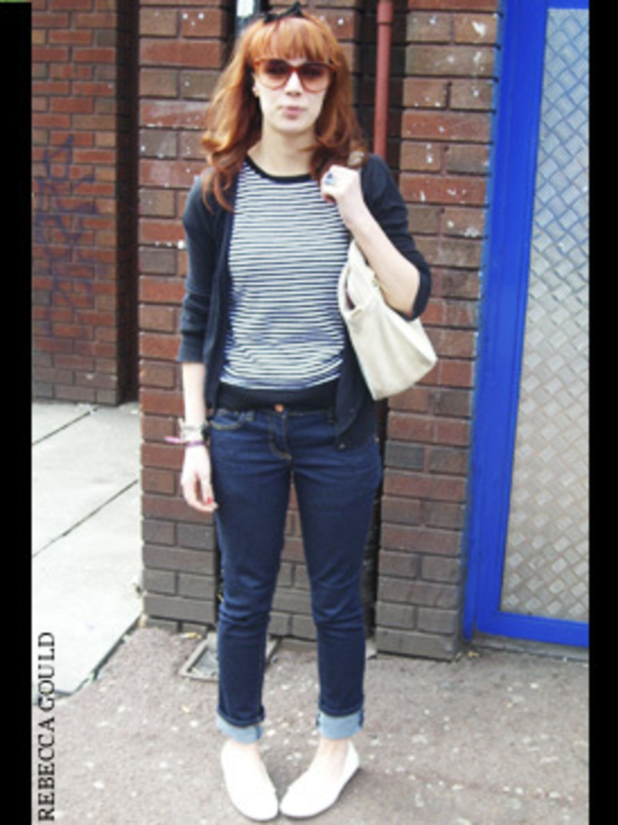 <p>A classic blue and white striped T-shirt is the easiest way to inject a bit of sailor chic into your everyday look. Team with your favourite jeans - hems rolled this season of course - a cardigan and retro, white pumps. Rachel has finished her look wit