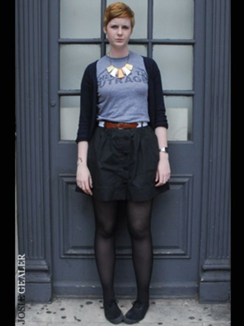 <p>T-shirts are not just for the weekend. Statement jewellery plus a smart leather belt and skirt make this look perfect for a laid back day at work.</p>