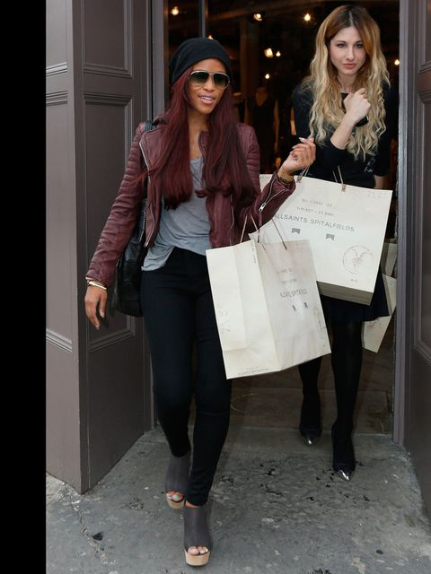 <p>Eve stops by an AllSaints store wearing an Oxblood biker, March 2013.</p>