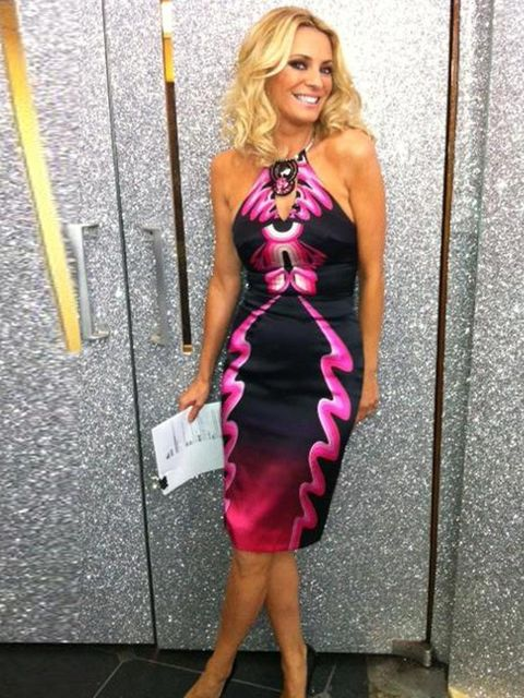 <p>Tess Daly in Holly Fulton's raspberry ripple halter neck dress.</p>