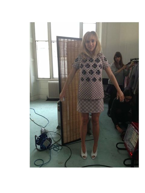 "<p>Suki wearing a dress by <a href=""http://www.style.com/fashionshows/review/S2014RTW-VVBECKHAM"">Victoria, Victoria Beckham</a></p>"