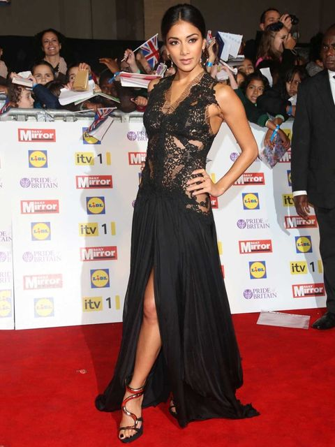 <p>Nicole Scherzinger teams her dramatic black lace dress with Giuseppe Zanotti heels at the Pride of Britain awards in London</p>