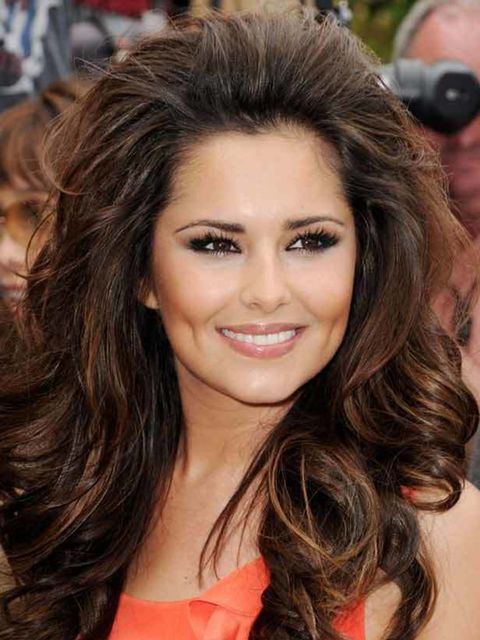<p>It's been a busy year for Cheryl's hairstylist Lisa Laudat. The X Factor judge went from dark chocolate mid-length locks to a lighter, highlighted shade before switching to a deep red hue and super-long extensions. The faux length didn't impress Team E