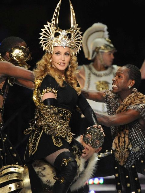 <p>Madonna wore a custom-made Philip Treacy headdress and Givenchy couture for her performance.</p>