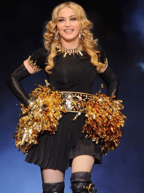 <p>Madonna performed her new song in a cheerleader costume.</p>
