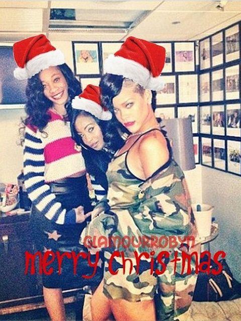 <p>Rihanna and friends in Santa hats</p>