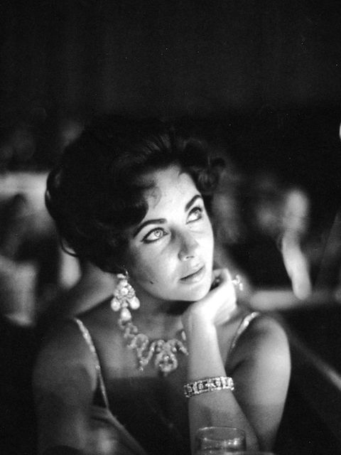 <p>Elizabeth Taylor watches her then-fiance Eddie Fisher as he performs on stage at the Tropicana in Las Vegas, 1959</p>
