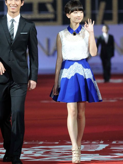 """<p>Zhou Dongyu wearing a lace <a href=""""http://www.elleuk.com/catwalk/designer-a-z/carven/autumn-winter-2012"""">Carven</a> blouse and flippy skirt at the Beijing Film Festival Opening</p>"""