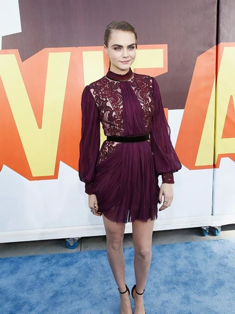 <p>Cara Delevingne attends the MTV Movie Awards in Los Angeles, wearing in a Reem Acra dress and Saint Laurent shoes.</p>