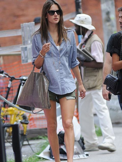 <p>Alessandra Ambrosio wearing an off-duty denim shirt and militray-inspired shorts </p>