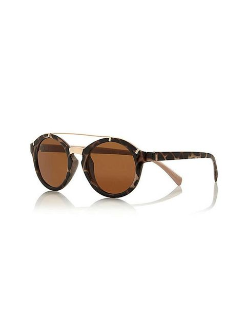 "<p>Bookings Assistant Amanda Arber will pair these shades with (her signature) head-to-toe black.</p>  <p><a href=""http://www.riverisland.com/women/sunglasses/round-sunglasses/brown-tortoise-shell-round-sunglasses-666375"" target=""_blank"">River Island</a>"
