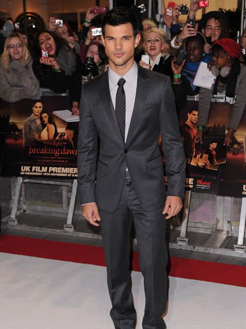 "<p>Taylor Lautner wears a custom <a href=""http://www.elleuk.com/catwalk/collections/emporio-armani/"">Emporio Armani</a> suit to the London premiere of <em>Breaking Dawn Part I.</em></p>"
